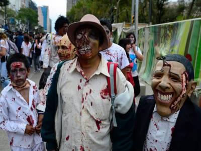 میکسیکو: سیکڑوں شہریوں نے جنوں، بھوتوں اور بدروحوں کا روپ دھار کر مقامی مذہبی تہوار روائتی جوش و جذبے سے منایا۔