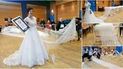 فرانس میں دنیا کا سب سے لمباعروسی لباس تیار