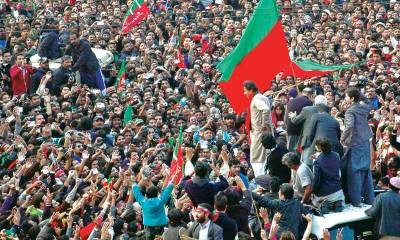 PTI workers celebrate in front of Imran Khan house in Banigala .