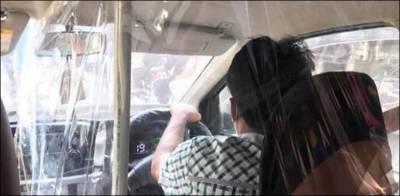 کراچی، آن لائن ٹیکسی ڈرائیور کا کرونا سے بچنے کے لیے انوکھا بندوبست